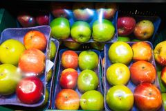Apples on boxes in supermarket Royalty Free Stock Photos