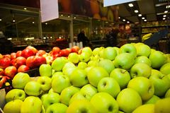 Apples on boxes in supermarket Stock Photos