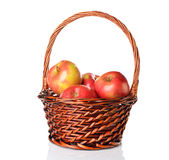 Apples in a brown basket Royalty Free Stock Photos