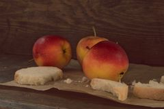 Apples on brown paper on wood. Vintage look Stock Photography
