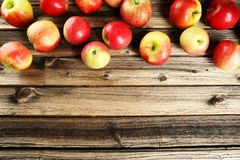 Apples on brown wooden background Royalty Free Stock Images