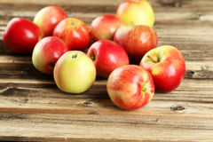 Apples on brown wooden background Royalty Free Stock Photography