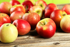 Apples on brown wooden background Stock Photography