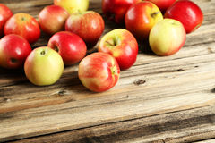 Apples on brown wooden background. Stock Images