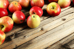 Apples on brown wooden background. Royalty Free Stock Photo