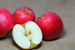 Apples on a burlap background. Royalty Free Stock Photo