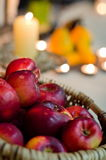 Apples and candles Royalty Free Stock Photos