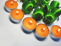 Apples and candles 3. Apples and candles on the grey background royalty free stock photography