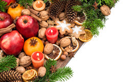 Apples, candles, tangerine fruits, walnuts, cookies and spices Royalty Free Stock Images