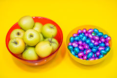 Apples and candy Stock Images