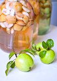 Apples and cans of stewed apples Stock Image