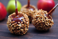 Apples in caramel with peanuts coating Royalty Free Stock Photo