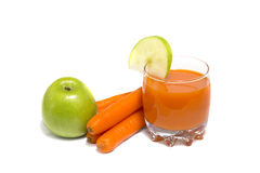 Apples, carrot and juice in glass Stock Images
