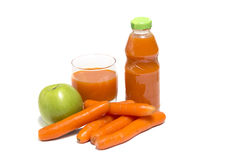 Apples, carrot and juice in glass Royalty Free Stock Images