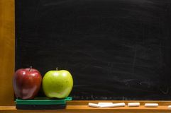 Apples and Challkboard at school Stock Photos