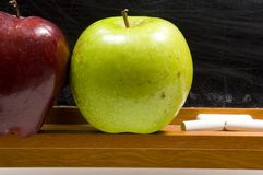 Apples and Challkboard at school - close up Royalty Free Stock Image