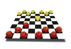 Apples on chessboard. Apples as chess pieces on a chessboard  on white background  metaphor concept Stock Photography