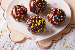 Apples in chocolate with candy sprinkles horizontal top view Stock Photos