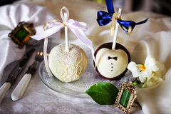 Apples in chocolate, white, black, milk, dark, wedding table decoration, design, interior Stock Photos