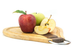 Apples on chopping block Stock Photography