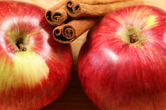 Apples and cinnamon. Sticks - closeup of the red juicy fruits Stock Photo