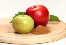 Apples and cinnamon. On a wooden board Stock Photography