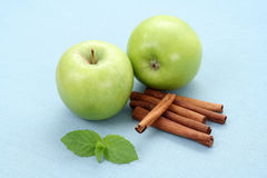 Apples and cinnamon Stock Image