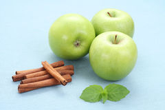 Apples and cinnamon Stock Photos