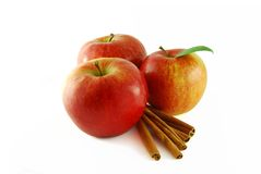 Apples with cinnamon. A few red apples with cinnamon on the white background royalty free stock image