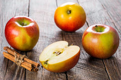 Apples with cinnamon. Apple with cinnamon on wooden background. Selective focus Stock Photography