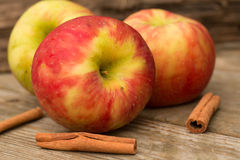 Apples and Cinnamon Sticks. In Autumn Stock Photo