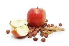 Apples, cinnamon sticks and hazelnuts Royalty Free Stock Photography