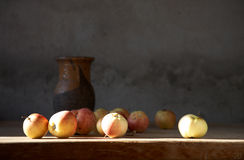 Apples and clay jug Stock Images