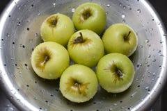 Apples on colander. Washed apples on steel colander Royalty Free Stock Image