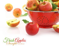 Apples in colander. Isolated on white Royalty Free Stock Photos