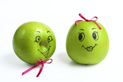 Apples with comically painted faces. On a white background Royalty Free Stock Photo