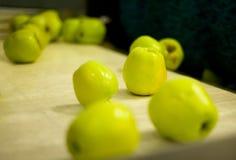 Apples on conveyor belt Stock Photo
