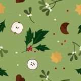 Christmas theme background with apples and cookies. Apples, cookies, mistletoe and holly tree - Christmas theme background Stock Photo