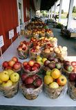 Apples on counter at farm stand Royalty Free Stock Image