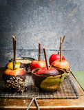 Apples covered with melted chocolate and almond Royalty Free Stock Image