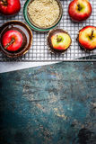 Apples covering with chocolate and chopped almond on rusticbackground Stock Photos