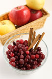 Apples, cranberries and cinnamon. Rolls Royalty Free Stock Photo