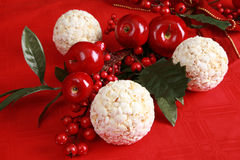 Apples, cranberries and popcorn balls Stock Photography