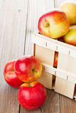 Apples in crate. Fresh red organic apples in wooden crate on table Royalty Free Stock Photo