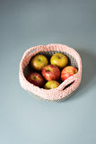 Apples in a Crocheted Woolen Basket Royalty Free Stock Images