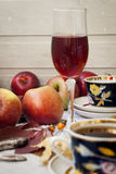 Apples, a cup of tea and a glass of wine Royalty Free Stock Photos