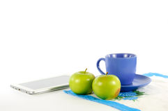 Apples with a cup of tea. On a white background Stock Image