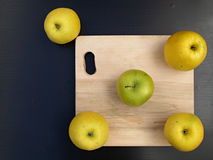 Apples and cutting board Stock Photo