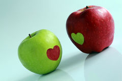 Apples decorated by hearts Stock Image