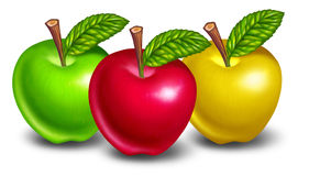 Apples of different colors. With red fruit in front and natures green and yellow treats in the background Royalty Free Stock Photo